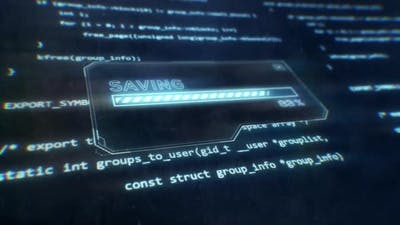 Computer Code Screen With Saving Notification