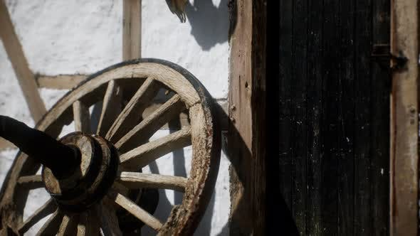Old Wood Wheel and Black Door at White House
