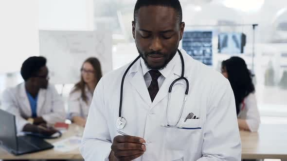 Thumbnail for Portrait of African Young Male Doctor with Team