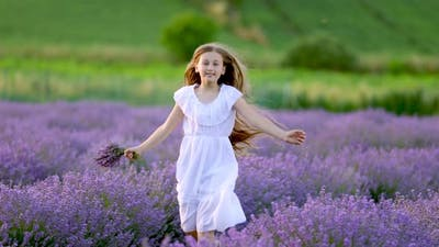a Girl Running in a Lavender Field