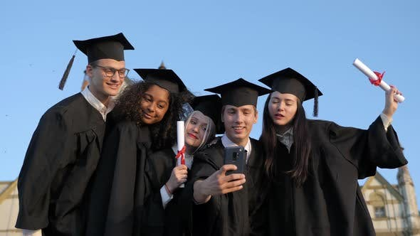 Thumbnail for Multi Ethnic Group of Graduated Students Taking Selfie