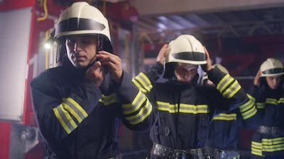 Team of Firefighters Putting on Helmets