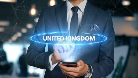Thumbnail for Businessman Smartphone Hologram Word Country   Capital  United Kingdom