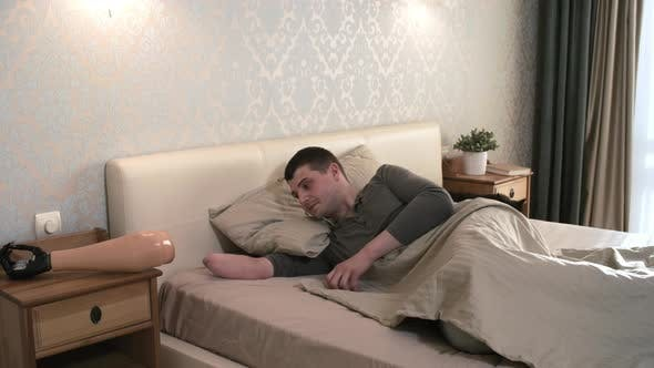 Thumbnail for Male Amputee Waking Up and Putting on Bionic Prosthetic Forearm