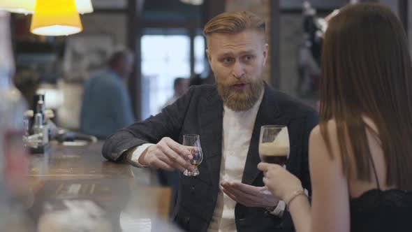 Thumbnail for Brunette Woman and Confident Blond Bearded Man Sitting at the Bar