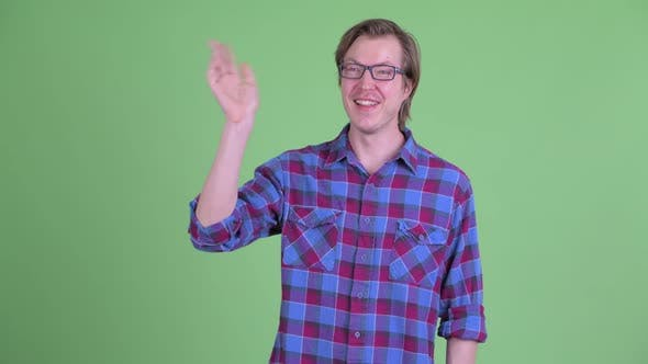 Thumbnail for Happy Young Handsome Hipster Man with Eyeglasses Waving Hand