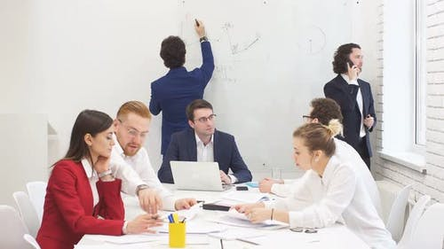 Young Successful Businessmen Came Together To Discuss a New Business Strategy.