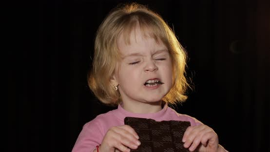 Thumbnail for Attractive Child Eating a Huge Block of Chocolate. Cute Blonde Girl