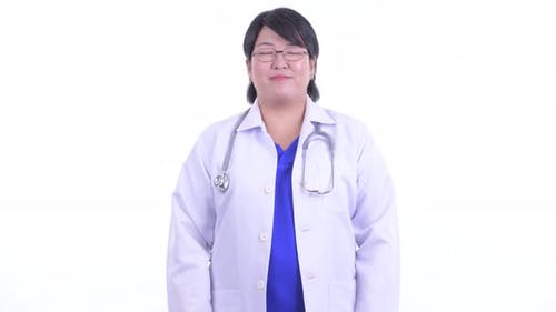 Happy Overweight Asian Woman Doctor Smiling