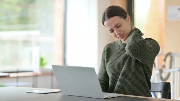 Young Woman with Laptop Having Neck Pain