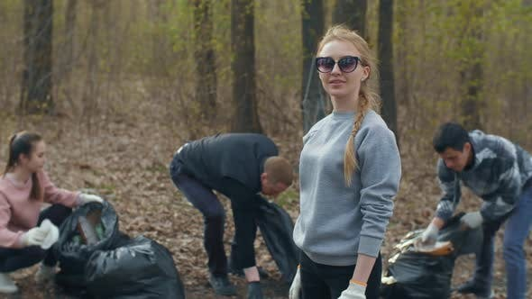 Thumbnail for Volunteers Collecting Garbage in the Forest