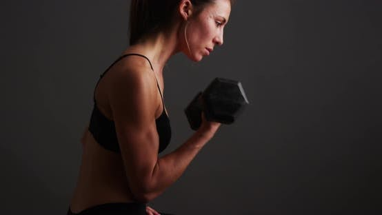 Thumbnail for Strong healthy mixed race woman lifting weights