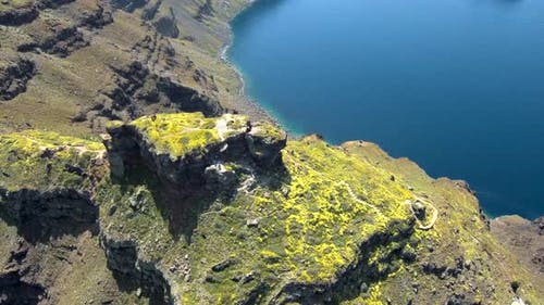 Aerial view from above of Skaros Rock at Santorini island