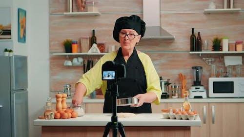 Elderly Woman Filming Cooking Vlog