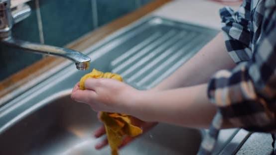 Thumbnail for Woman Washing Napkin At Sink