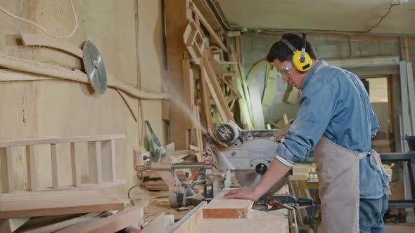 Thumbnail for Young Woodworker Operating Bandsaw