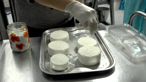 Woman Making Cheese From Sheeps Milk