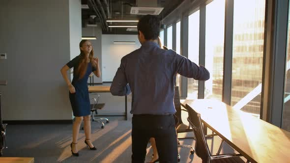 Thumbnail for Group of Businesspeople Dancing in Office.