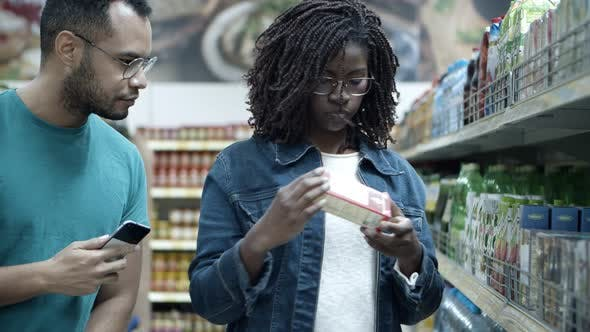 Thumbnail for Happy Young Couple Making Purchases in Grocery Store