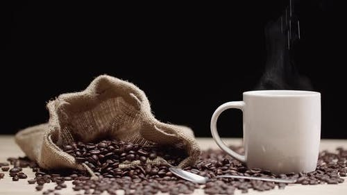 Sugar in Steamy Coffee Cup
