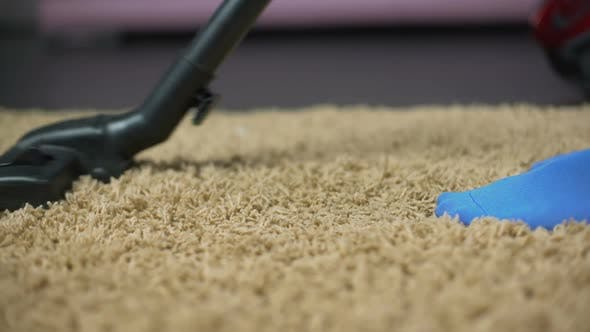 Thumbnail for Female vacuuming rug to prevent allergy reaction, removing dirt from carpet