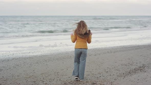Thumbnail for Redheaded Teenager Walking Along Beach