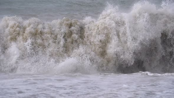 Cover Image for Storm on the Sea. Huge Waves Are Crashing and Spraying on the Shore