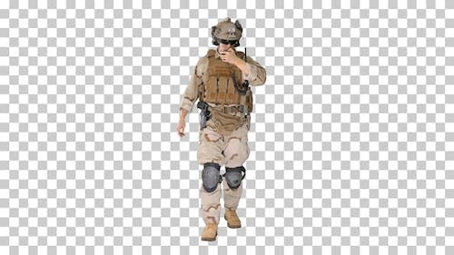 Ranger walks, holds a radio station and gives orders, Alpha Channel