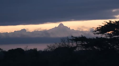 Summit of Mount Kenya in the clouds at sunrise