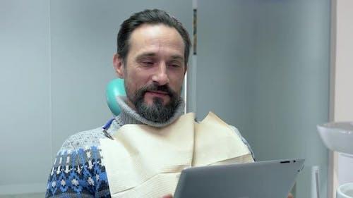 Man in Dentist Office.