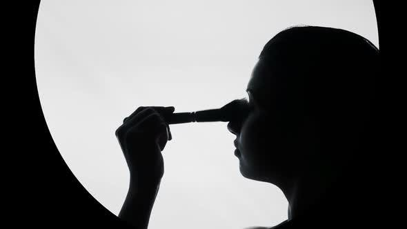 Thumbnail for Beautiful Young Lady Putting Makeup on Face, Touching Skin With Brush Gently