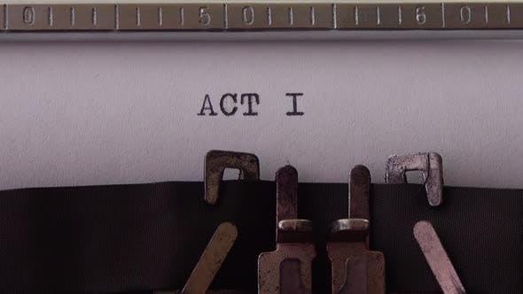 ACT I - printed on an old typewriter, close up.