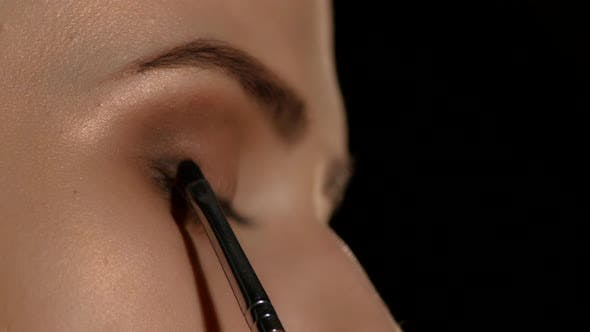 Cover Image for Woman Applying Make Up To Woman. Black. Closeup