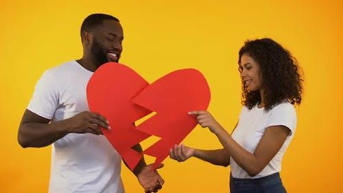 Multiracial Pair Connecting Paper Heart, Reconciliation After Quarrel, Relations
