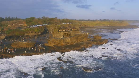 Thumbnail for Tourist Crowd Walk Into the See To Pura Tanah Lot, Hindu Temple
