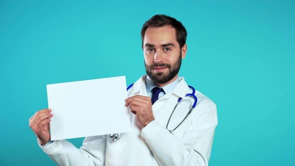 Thumbnail for Portrait of Man in Medical Coat Holding White Horizontal Paper Isolated on Blue