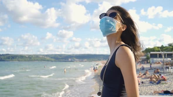 Enthusiastic Woman Wearing Protective Face Mask at the Beach in Varna Bulgaria
