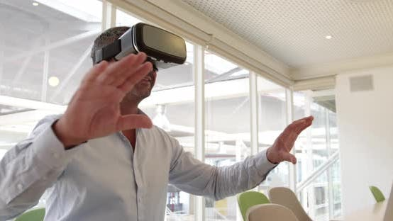 Thumbnail for Businessman using virtual reality headset at desk in modern office 4 4k