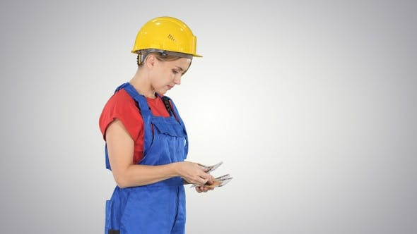 Thumbnail for Young woman engineer or architect holding banknotes euros