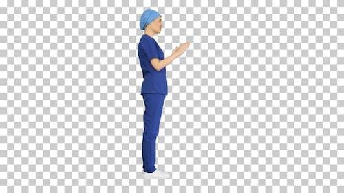 Female doctor in blue uniform talking, Alpha Channel