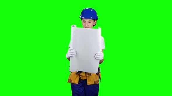 Thumbnail for Designer of the Construction Site Carries a Drawing. Green Screen