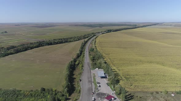 Thumbnail for Aerial view of a country road and fields