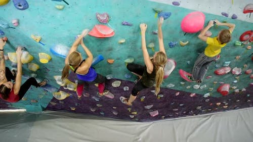 Group of Climbers Bouldering at Indoor Wall