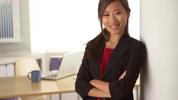 Thumbnail for Happy Chinese businesswoman standing