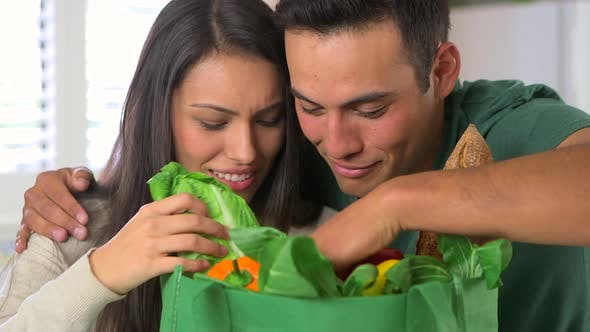 Thumbnail for Mexican couple looking through grocery bags