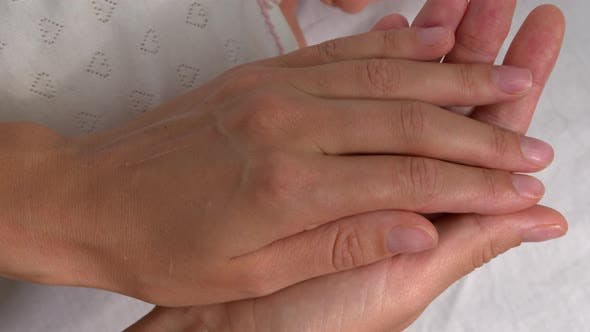 Thumbnail for The Mother with Newborn Baby Hand, Holding Baby Hand Feeling Love in Touch.