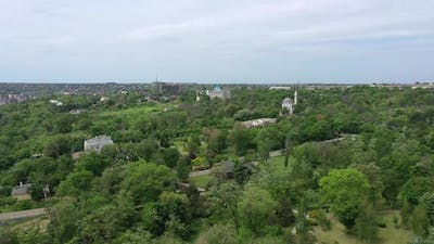 A bird's eye view of the city garden. Among the trees you can see a mosque