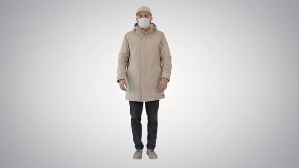 Thumbnail for Young Man in Flu Mask Standing Doing Nothing on Gradient Background