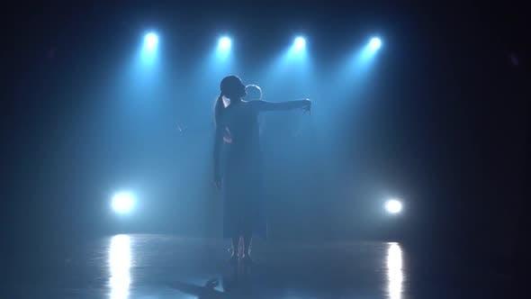 Thumbnail for Diligent Ballet Dancers Performing Dancing Elements Modern Ballet Over Spotlights