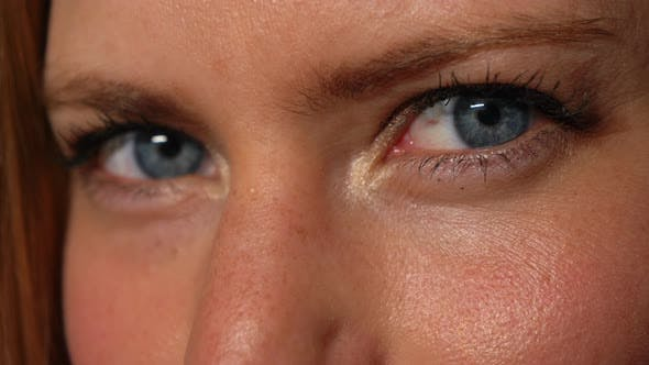 Womans Blue Eyes Winking
